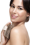 Beautiful young woman applying scrub glove on her perfect skin Stock Images