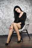 Beautiful young woman in a armchair Stock Image