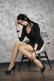 Beautiful young woman in a armchair Stock Images