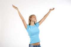 Beautiful young woman with arms raised Stock Photo