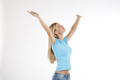 Beautiful young woman with arms raised. Isolated on white Stock Photography