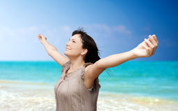 Beautiful young woman with arms raised royalty free stock photography