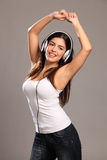 Beautiful Young Woman Arms Raised Dancing To Music Royalty Free Stock Image