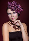 Beautiful young woman with artificial rouses on head necklace an Royalty Free Stock Photography