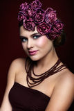 Beautiful young woman with artificial rouses on head necklace an Royalty Free Stock Photo
