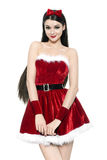 Beautiful young woman as cute santa girl Stock Image