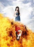 Gorgeous angel and devil. Beautiful young woman as gorgeous angel and devil on half heaven half hell background royalty free stock photography