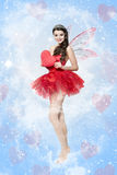 Beautiful young woman as love fairy Stock Photography