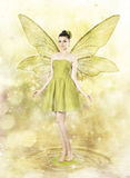 Beautiful young woman as spring fairy. On golden magical background royalty free stock image
