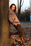Beautiful young woman in autumn. Beautiful young woman near the tree in autumn stock photography
