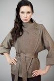 Beautiful young woman in autumn coat Stock Photos