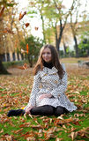 Beautiful young woman at autumn day. Beautiful young woman at fall stock photo