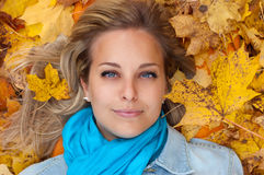 Beautiful young woman in autumn forest Royalty Free Stock Photo