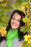 Beautiful young woman in autumn forest Royalty Free Stock Photography