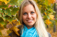 Beautiful young woman in autumn forest Royalty Free Stock Images