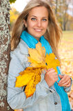 Beautiful young woman in autumn forest Stock Photo