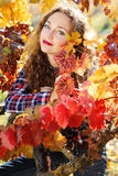 Beautiful young woman in autumn grape vineyard Stock Images