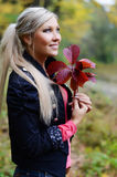 Beautiful young woman with autumn leaves in hands Stock Photography