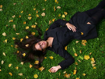 Beautiful young woman in autumn park. A beautiful young woman in autumn park stock images