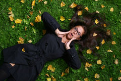 Beautiful young woman in autumn park. A beautiful young woman in autumn park stock photo