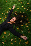 Beautiful young woman in autumn park. A beautiful young woman in autumn park royalty free stock photography