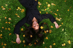 Beautiful young woman in autumn park. A beautiful young woman in autumn park royalty free stock images