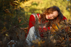 Beautiful young woman in autumn park Stock Photos