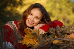 Beautiful young woman in autumn park Royalty Free Stock Image