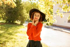 Beautiful young woman in autumn Park in black hat stock photos