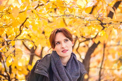 Beautiful young woman in autumn park Stock Photography