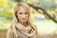Beautiful young woman - autumn portrait. Beautiful young blond woman - colorful autumn portrait stock photography