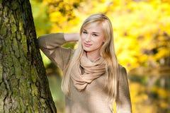 Beautiful young woman - autumn portrait. Beautiful young blond woman - colorful autumn portrait royalty free stock photos
