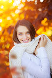 Beautiful young woman autumn portrait with scarf Stock Photo