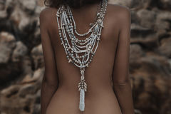 Beautiful young woman back with ethnical necklace close up Stock Photo