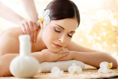 Beautiful young woman on a back massage procedure Royalty Free Stock Image