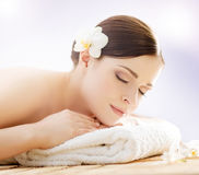 Beautiful young woman on a back massage procedure Royalty Free Stock Images