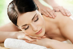 Beautiful young woman on a back massage procedure Royalty Free Stock Photography