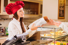 Beautiful young woman in a bakery Royalty Free Stock Image