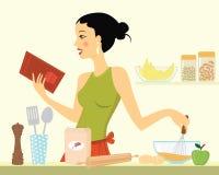 Beautiful young woman baking Stock Photo