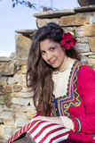 Beautiful young  woman with balkan folk red costume Royalty Free Stock Photography