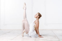 Beautiful Young Woman Ballerina. Stretching Warming Up In White Interior Stock Photography