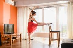 Ballet dancer stretching at home at quarantine
