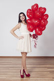 Beautiful young woman with balloons Royalty Free Stock Photography