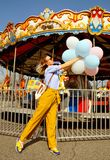 Beautiful young woman with balloons in the amusement park Royalty Free Stock Images