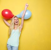 Beautiful young woman with balloons Royalty Free Stock Image
