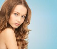 Beautiful young woman with bare shoulders Stock Photos