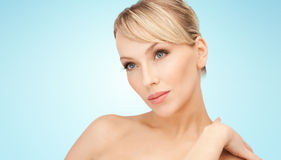 Beautiful young woman with bare shoulders Stock Images
