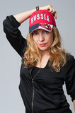 Beautiful young woman in a baseball cap Royalty Free Stock Photo