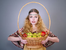 Beautiful young woman with a basket of apples Stock Photos