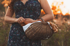 Beautiful young woman with a basket full of fresh baked bread Royalty Free Stock Images